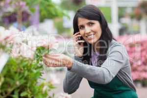 Florist touching a flower while calling