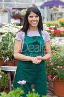 Happy assistant in garden center