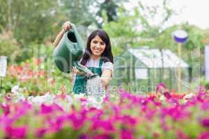 Cheerful gardener watering plants