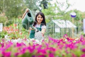 Happy employee watering plants