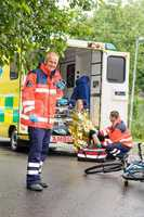 Paramedics helping woman bike accident ambulance