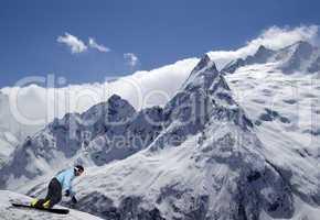 Snowboarder descends a slope