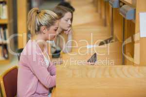 Woman using tablet pc to study