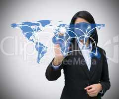 Businesswoman pressing world map hologram