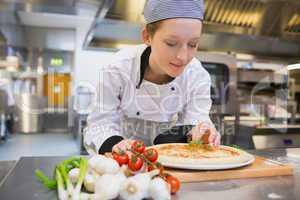 Woman preparing pizza