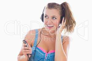Eighties styled woman listening to music