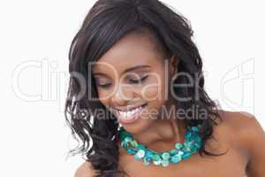 Woman smiling and wearing necklace