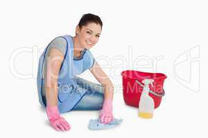 Cleaning woman wiping up the floor