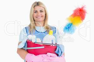 Cleaner woman holding a pink bucket with cleaning supplies