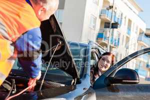 Car troubles woman starting broken vehicle
