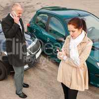 Woman and man on phone car crash