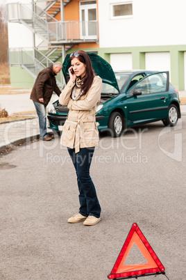 Upset woman on the phone car problem