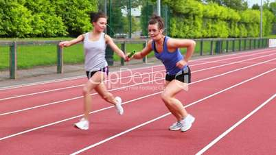 Women running relay race