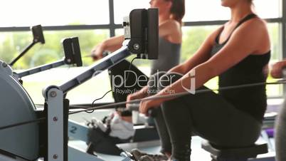 Women working out on rowing machine