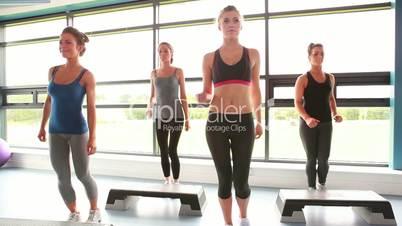 Female group doing aerobics