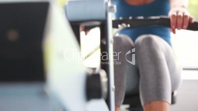 Woman drawing on row machine