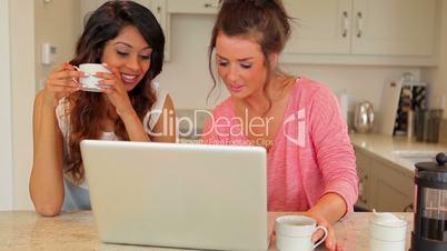 Women laughing at laptop