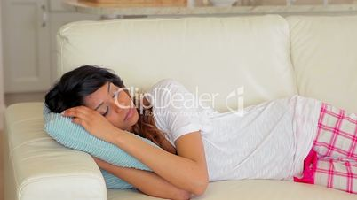Woman sleeping on the couch