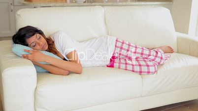Woman lying on the couch sleeping