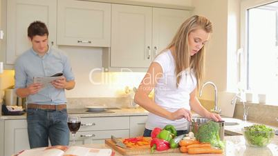 Man tasting what woman is cooking
