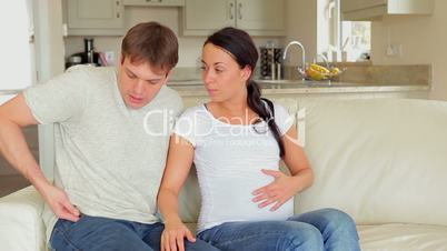 Husband calling ambulance for pregnant wife
