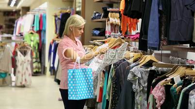 Woman looking at dress and smiling