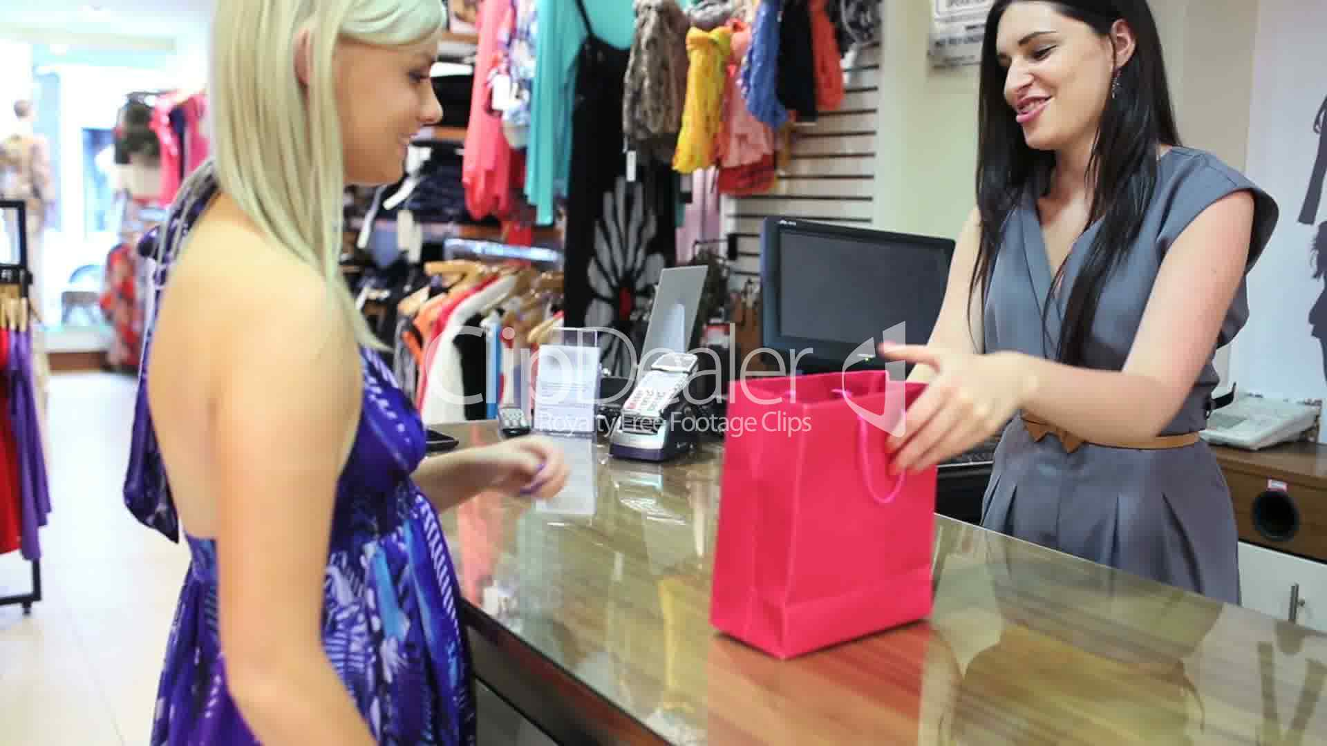 Woman Buying Clothes At Till Royalty Free Video And Stock