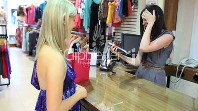 Cashier giving credit card back to customer