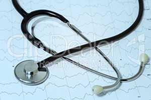 Medical stethoscope on background EEG brain