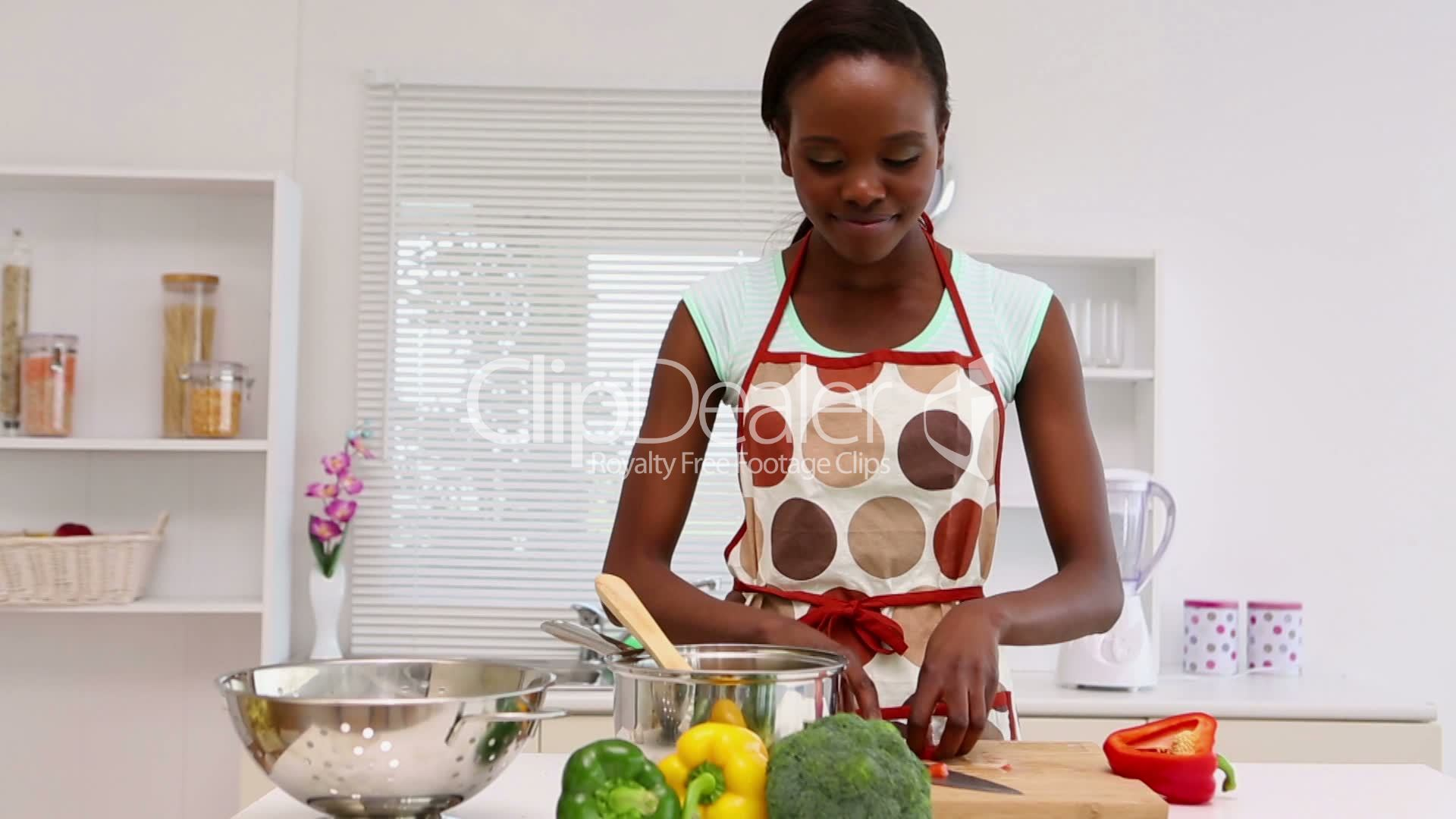 Woman is cooking in the kitchen: Royalty-free video and stock footage