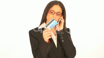 Businesswoman doing telephone banking