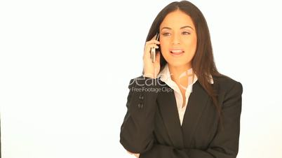 Beautiful businesswoman using her mobile
