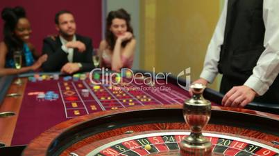 Dealer spinning the roulette wheel