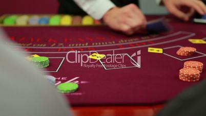 Dealer dealing poker cards