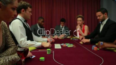 Two men left in poker game with everyone else folding