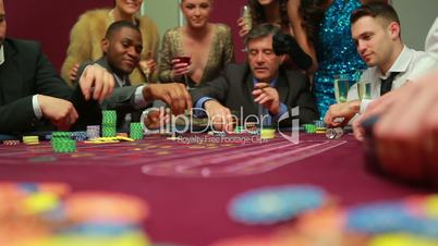 Men placing bets and waiting for dealer