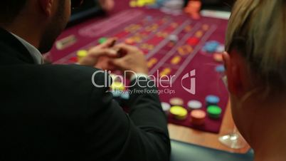 Woman talking to man at roulette table