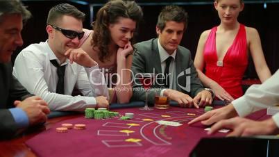 Man in sunglasses winning at blackjack