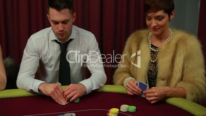 Man and woman only people left in poker game and woman winning