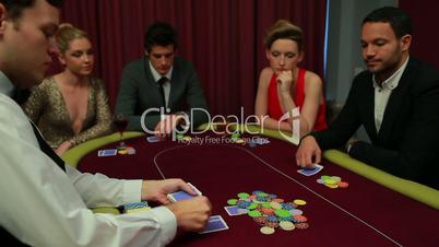 Dealer placing cards
