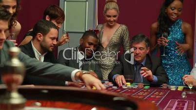 People placing bets for roulette