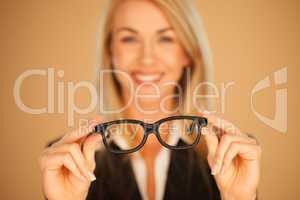 Woman holding out her spectacles