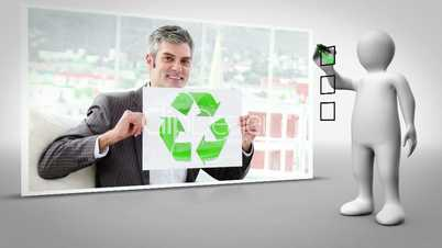 Clip of businessman holding up recycling symbol