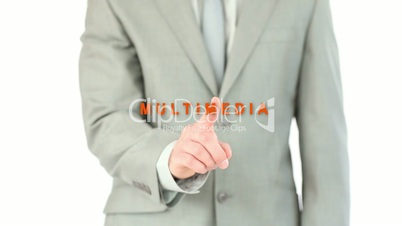 Businessman touching the word multimedia