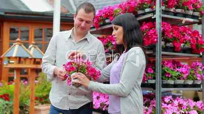 Customers standing next to a flower shelf