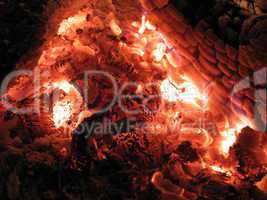 red and hot embers in stove close up