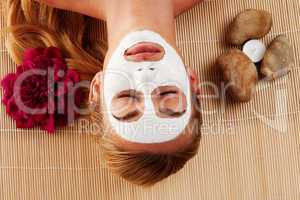 Relaxed woman with a face mask