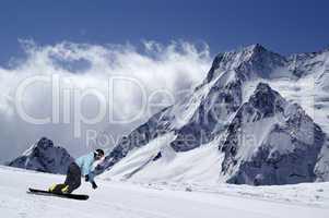 Snowboarder on piste slope