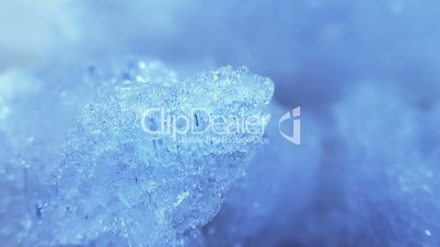 thawing blue ice close-up timelapse
