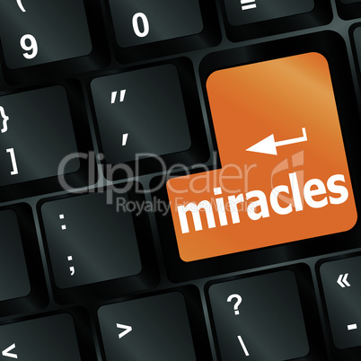 Computer keyboard with miracles text on key